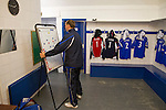 Lancaster City 0 FC Halifax Town 3, 15/10/2011, Giant Axe, FA Cup Third Qualifying Round. Lancaster City assistant manager Phil Brown adjusting a tactics board in the home dressing room prior to the club's FA Cup third qualifying round match against FC Halifax Town at Giant Axe, Lancaster. The visitors, who play two leagues above their hosts in the English football pyramid, won the ties by three goals to nil, watched by a crowd of 646 spectators. Lancaster City were celebrating their centenary in 2011, although there was a dispute over the exact founding date over the club known as Dolly Blue. Photo by Colin McPherson.