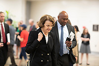 United States Senator Dianne Feinstein, Democrat of California, talks with reporters in the Senate Subway during a Senate vote on Capitol Hill in Washington, DC on July 7, 2018. <br /> CAP/MPI/RS<br /> &copy;RS/MPI/Capital Pictures