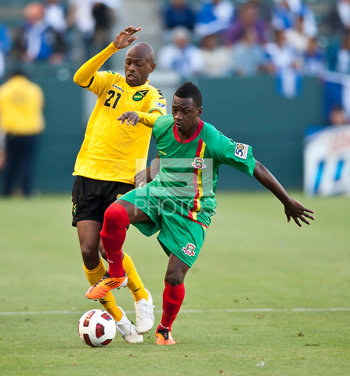 CARSON, CA – June 6, 2011: Greneda player Joseph Lancaster (16) battles Jamaican player Shelton Luton (21) during the match between Grenada and Jamaica at the Home Depot Center in Carson, California. Final score Jamaica 4 and Grenada 0.