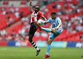 28th May 2018, Wembley Stadium, London, England;  EFL League 2 football, playoff final, Coventry City versus Exeter City; Maxime Biamou of Coventry City attempting to clip the ball over Hiram Boateng of Exeter City