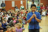 NWA Media/ANDY SHUPE - Students at Washington Elementary School in Fayetteville participate in the school's annual spelling bee Friday, Dec. 19, 2014, in the school's gymnasium. Aiden Kelly, 10, a fifth-grader, will represent the school in the county spelling bee in January.