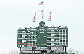 View of the iconic, hand-operated scoreboard at Wrigley Field during the seventh inning of the game between the Washington Nationals and the Chicago Cubs on Thursday, <br /> Credit: Ron Sachs / CNP