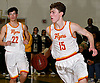 Robert Connors #15 of Chaminade, right, dribbles downcourt during the Nassau-Suffolk CHSAA varsity boys basketball semifinals against St. Anthony's at LIU Post on Sunday, Feb. 26, 2017. Chaminade won by a score of 66-50.