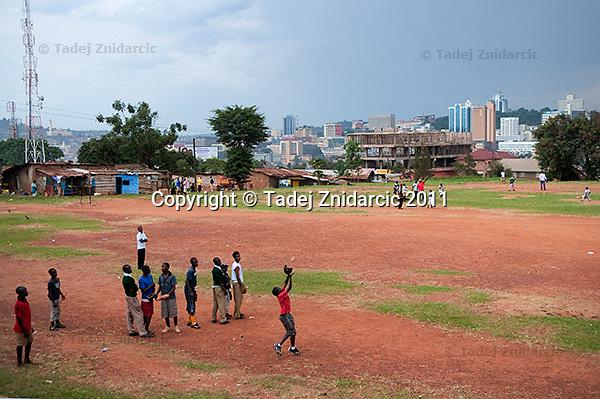 Jonathan Kizza, 11, catches a ball during baseball practice at sports field of St. Peter's School in Nsambya, neighbourhood of Kampala, Uganda on July 28 2011. Jonathan Kizza plays 2nd base on Rev. John Foundation Little League baseball team.