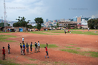 Jonathan Kizza, 11, catches a ball during baseball practice at sports field of St. Peter's School in Nsambya, neighbourhood of Kampala, Uganda on July 28 2011. Jonathan Kizza plays 2nd base on Rev. John Foundation Little League baseball team.