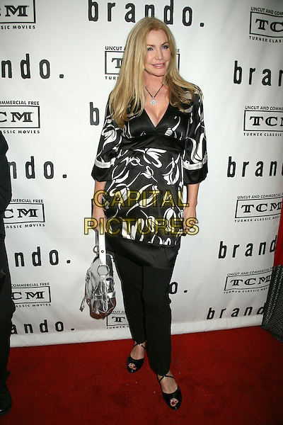 "SHANNON TWEED.""Brando"" Los Angeles Premiere at the Egyptian Theatre, Hollywood, California, USA.April 17th, 2007.full length black trousers top white pattern silver bag purse .CAP/ADM/BP.©Byron Purvis/AdMedia/Capital Pictures"