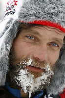 Monday March 5, 2012  Frosty bearded Hank Debruin at the Finger Lake checkpoint during Iditarod 2012.