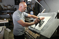 Alberto is brushing a folio of parchment with a sander at the tannery factory of Scriptorium SL in Valencia, Spain. Picture by Manuel Cohen