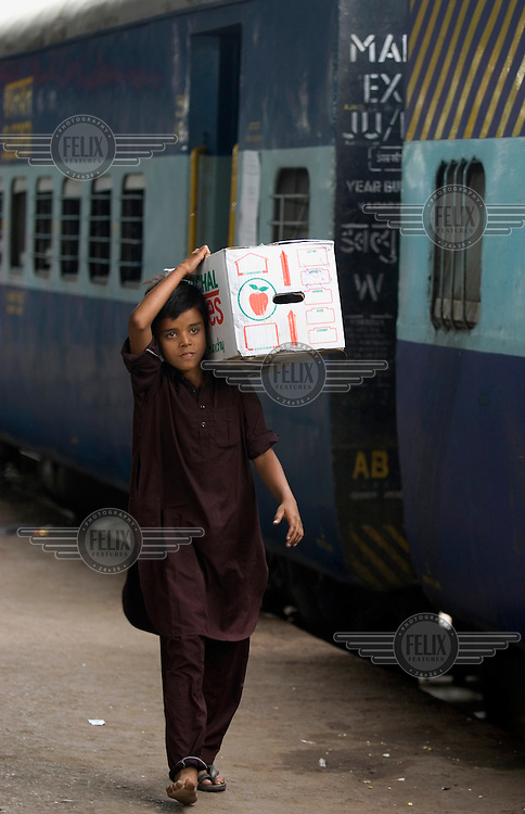 14 year old Sashi is a street kid living in Bhopal train station. He collects rubbish from the carriages and train station to sell.