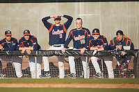 The Virginia Cavaliers bench watches the action at Clark-LeClair Stadium on February 19, 2010 in Greenville, North Carolina.   Photo by Brian Westerholt / Four Seam Images