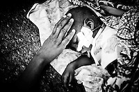 Malnutrition in the Horn of Africa.<br /> <br /> Ahmed, a child affected by malnutrition, sleeps on a bed with his mother's protective hand on the head in the pediatric and malnutrition branch of the hospital of Hargeisa, the capital city of Somaliland in the Horn of Africa.<br /> The Northern region of former Somalia Republic reached its independence from the southern part in 1988 after a long period of civil war, but it is not actually recognized by any international country and community.     <br /> Hargeisa, Somaliland - 7th Aug 2011<br /> © Giorgio Perottino