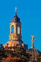 "Statue of an angel holding the ""Trumpet of Fame"" atop the glass dome known as the Lemon Squeezer (Zitronenpresse) on the Kunstakademie (Art Academy) with the Frauenkirche (church) behind, Dresden, Saxony, Germany"
