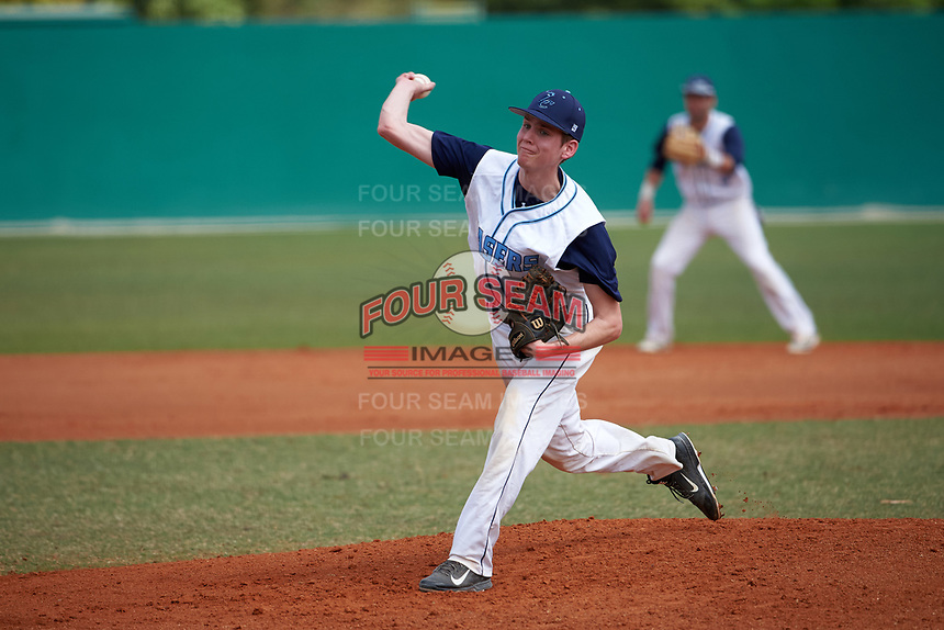 Lasell Lasers pitcher Daniel Petr (19) delivers a pitch during the first game of a doubleheader against the Edgewood Eagles on March 14, 2016 at Terry Park in Fort Myers, Florida.  Edgewood defeated Lasell 10-2.  (Mike Janes/Four Seam Images)