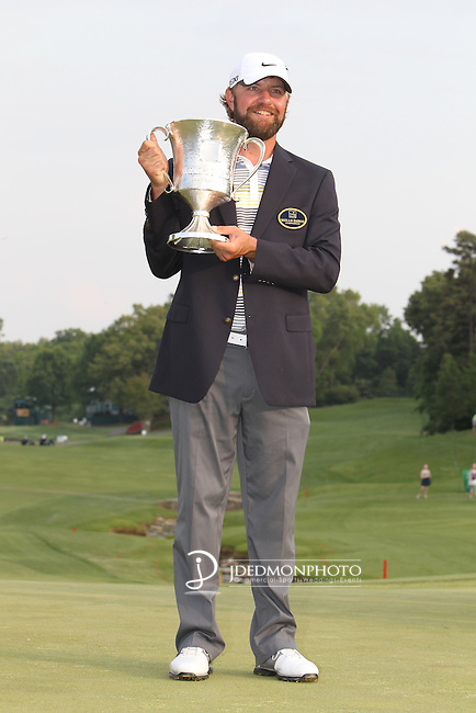 May 8,2011 - Lucas Glover holds the winners trophy and dons the winners jacket from Quail Hollow.  Lucas Glover wins the tournament in sudden death over Jonathan Byrd at Quail Hollow Country Club,Charlotte,NC.