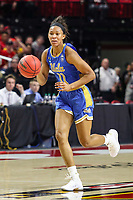College Park, MD - March 25, 2019: UCLA Bruins forward Lajahna Drummer (11) dribbles the ball up the court during game between UCLA and Maryland at  Xfinity Center in College Park, MD.  (Photo by Elliott Brown/Media Images International)