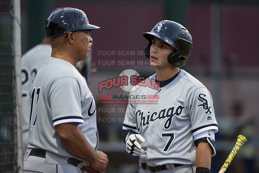 AZL White Sox designated hitter Nick Madrigal (7) talks to coach Jerry Hairston, Sr. (17) before an at bat during an Arizona League game against the AZL Cubs 2 at Sloan Park on July 13, 2018 in Mesa, Arizona. The AZL Cubs 2 defeated the AZL White Sox 6-4. (Zachary Lucy/Four Seam Images)