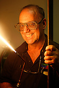 Scott Saxon, owner of the Durham TechShop, with his favorite bowtorch and custom glasses made from steel made with a high-end plasma cutter on site at the TechShop.