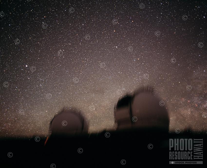 Stars and the Milky Way rising behind the Keck Telescope domes, Mauna Kea, Hawaii.