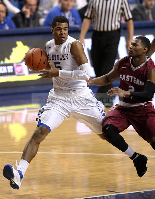UK guard Andrew Harrison (5) drives the ball down the court against EKU guard Corey Walden (2) during the first half of the University of Kentucky men's basketball game vs. Eastern Kentucky University at Rupp Arena in Lexington, Ky., on Sunday, December 7, 2014. UK won 82 - 49. Photo by Tessa Lighty | Staff