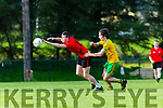 Tadhg O'Shea Fossagets his finger tips on the ball ahead of Fergus McAulliffe Gneeveguilla during their Div 3 clash in Gneeveguilla on Friday evening