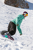 USA, California, Mammoth, USA, California, Mammoth, a female snowboarder carves her through the fresh snow at Mammoth Ski Resort