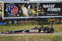 Sept. 21, 2012; Ennis, TX, USA: The car of NHRA top fuel dragster driver Steve Torrence is towed back to the pits during qualifying for the Fall Nationals at the Texas Motorplex. Mandatory Credit: Mark J. Rebilas-US PRESSWIRE