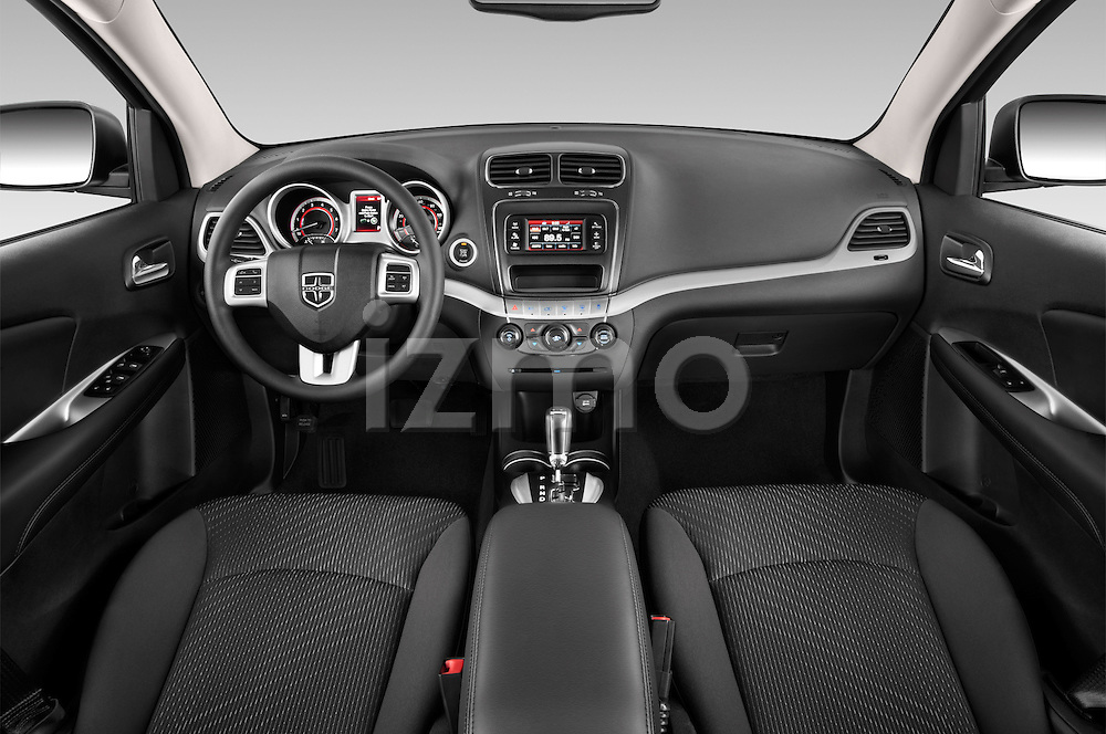 Stock photo of straight dashboard view of a 2015 Dodge Journey American Value Package 5 Door SUV Dashboard