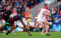 Picture by Alex Whitehead/SWpix.com - 30/03/2018 - Rugby League - Betfred Super League - St Helens v Wigan Warriors - Totally Wicked Stadium, St Helens, England - St Helens' James Roby makes a break from Wigan's Thomas Leuluai.
