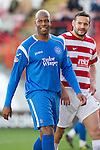Hamilton Accies v St Johnstone..23.10.10  .Michael Duberry has a laugh with Accies Mark McLaughlin.Picture by Graeme Hart..Copyright Perthshire Picture Agency.Tel: 01738 623350  Mobile: 07990 594431