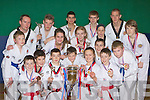 Killarney Traditional Taekwondo Association who won medals at the British Open Championships in Glasgow last weekend front row l-r: Micha?el Devlin, David Murphy, Lisa O'Leary, Eoin Daly. Second row: Andrew Brosnan, Kevin Brosnan, Ben Lyne, Daniel Devlin, Paul Brosnan. Third row: Albert Short, Lauren Kennelly, Rachel Randles, Stephanie Watson assistant Coach, Eoin O'Sullivan. Back row: Jonas Lyne, Marek Dzurko, Eoin O'Riordan and Bobby Enright Chief Instructor