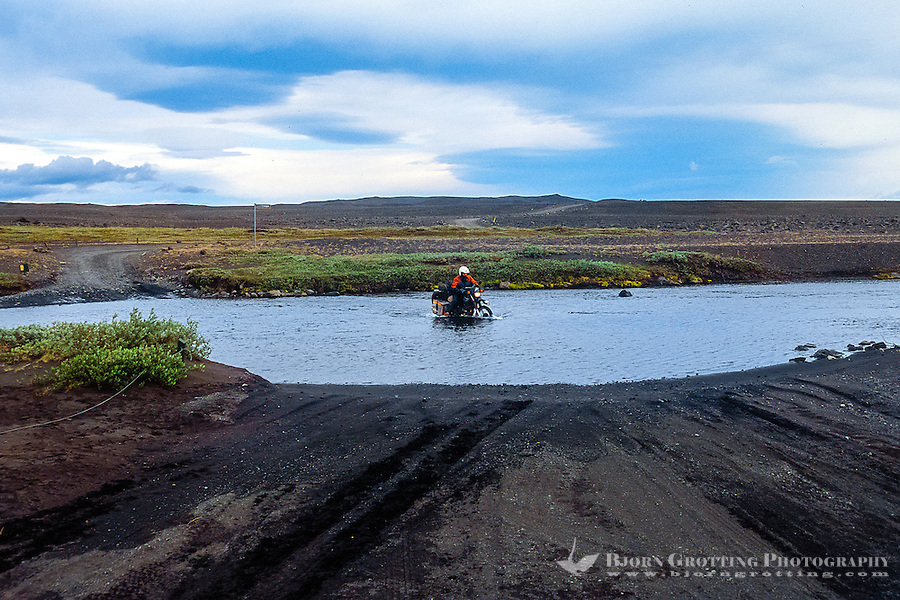 Iceland. River along the road to Askja in the highlands of Iceland. Crossing with bike.