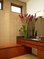 His master bath with mocha glass tile