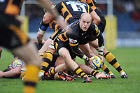Joe Simpson looks to pass the ball back from a ruck. Aviva Premiership match, between London Wasps and Sale Sharks on December 23, 2012 at Adams Park in High Wycombe, England. Photo by: Patrick Khachfe / Onside Images