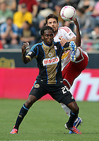 CHESTER, PA - OCTOBER 27, 2012:  Keon Daniel (26) of the Philadelphia Unionloses the ball to a high kick from  Heath Pearce (3) of the New York Red Bulls during an MLS match at PPL Park in Chester, PA. on October 27. Red Bulls won 3-0.