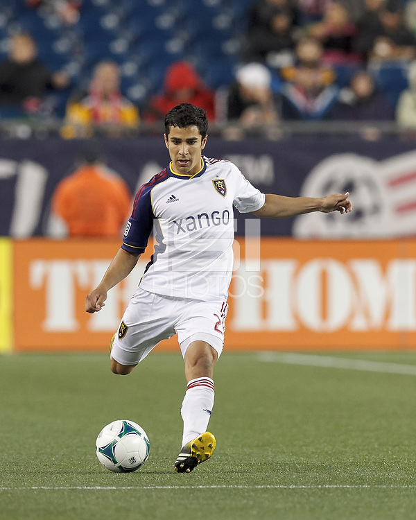 Real Salt Lake defender Tony Beltran (2) fakes pass as he brings the ball forward.
