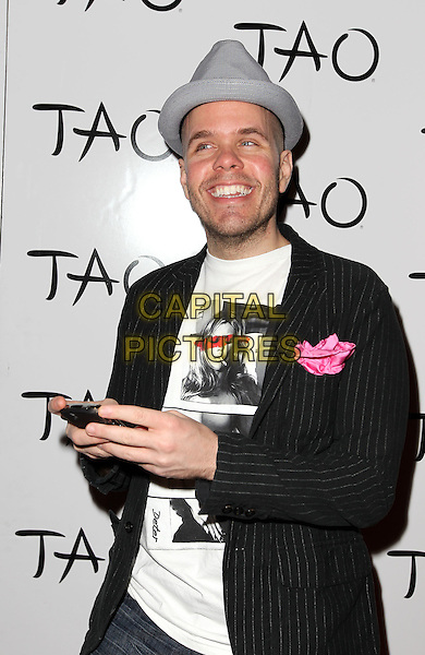 PEREZ HILTON (Mario Armando Lavandeira, Jr.) .Perez Hilton hosts a celebrity Tweet up at Tao Nightclub inside the Venetian Resort Hotel and Casino, Las Vegas, Nevada, USA, 22nd April 2011..half length grey gray hat black jacket blazer white t-shirt  face photo woman pinstripe .CAP/ADM/MJT.© MJT/AdMedia/Capital Pictures.