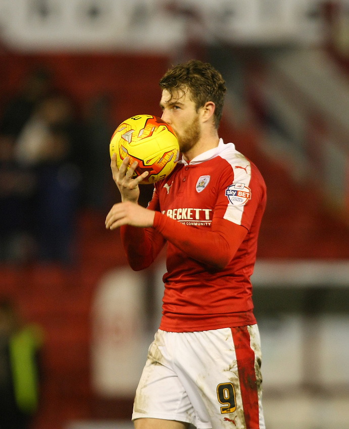 Barnsley's Sam Winnall kisses the match ball after scoring a hat-trick.<br /> <br /> Photographer Alex Dodd/CameraSport<br /> <br /> Football - The Football League Sky Bet League One - Barnsley v Rochdale - Saturday 23rd January 2016 - Oakwell Stadium - Barnsley    <br /> <br /> &copy; CameraSport - 43 Linden Ave. Countesthorpe. Leicester. England. LE8 5PG - Tel: +44 (0) 116 277 4147 - admin@camerasport.com - www.camerasport.com