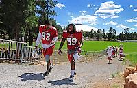 Aug. 1, 2009; Flagstaff, AZ, USA; Arizona Cardinals defensive end (93) Calais Campbell and linebacker (59) Will Davis head to the field for training camp on the campus of Northern Arizona University. Mandatory Credit: Mark J. Rebilas-