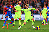 Alberto Moreno and Wilfried Zaha during the EPL - Premier League match between Crystal Palace and Liverpool at Selhurst Park, London, England on 29 October 2016. Photo by Steve McCarthy.