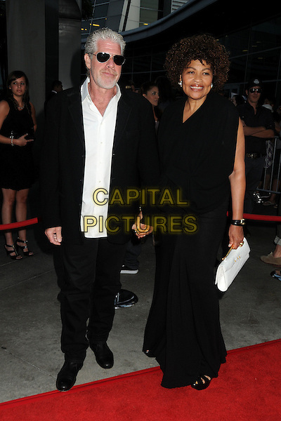 "Ron Perlman & Opal Stone.""Sons Of Anarchy"" Season 4 Premiere Screening held at the Cinerama Dome, Hollywood, California, USA..August 30th, 2011.full length suit dress holding hands married husband wife black white sunglasses shades beard facial hair .CAP/ADM/BP.©Byron Purvis/AdMedia/Capital Pictures."