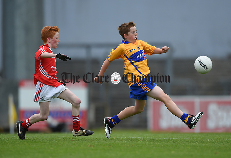 Ben O Neill of Clare in action against Conor Casey of Cork during their Primary Go Game at Pairc Ui Rinn, Cork, last weekend. Photograph by John Kelly.