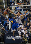 Nevada forward Trey Porter (15) blocks the shot of South Dakota State guard David Jenkins (5) in the first half of an NCAA college basketball game in Reno, Nev., Saturday, Dec. 15, 2018. (AP Photo/Tom R. Smedes)