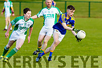 Gary O'Leary, Cordal heads away with the ball with Ballyduff's Alan Cronin giving chase when the sides met in Ballyduff last Saturday evening.