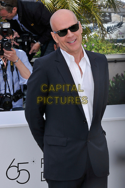 Bruce Willis.'Moonrise Kingdom' photocall at the 65th  Cannes Film Festival, France 16th May 2012.half length suit black white sunglasses shades shirt.CAP/PL.©Phil Loftus/Capital Pictures.