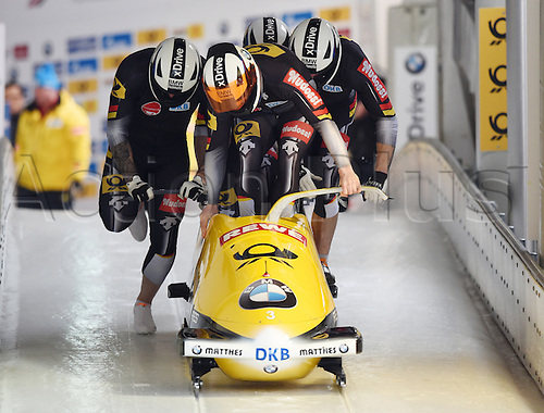 28.02.2016. Koenigssee, Germany.  German bobbers Maximilian Arndt, Alexander Roediger, Kevin Kuske and Martin Putze take off during the Bobsled World Cup in Koenigssee, Germany, 28 February 2016.