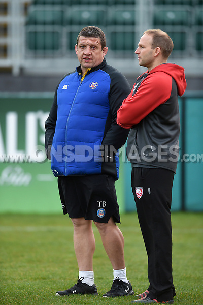 Bath Rugby first team coach Toby Booth speaks with Gloucester Rugby coach Richard Whiffin during the pre-match warm-up. Premiership Rugby Shield match, between Bath United and Gloucester United on April 8, 2019 at the Recreation Ground in Bath, England. Photo by: Patrick Khachfe / Onside Images