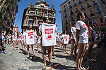 Pro-animal rights activists hold placards after spreading red powder on themselves and breaking fake 'banderillas' (spears to jab the bull) to protest against bullfighting and bull-running during a demonstration called by the People for the Ethical Treatment of Animals (PETA) and Anima Naturalis pro-animal groups on the eve of the San Fermin festivities in the Northern Spanish city of Pamplona on July 5, 2017.(ALTERPHOTOS/Rodrigo Jimenez)