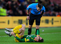 Referee Keith Stroud checks on the injured Alan Browne of Preston North End<br /> <br /> Photographer Alex Dodd/CameraSport<br /> <br /> The EFL Sky Bet Championship - Middlesbrough v Preston North End - Wednesday 13th March 2019 - Riverside Stadium - Middlesbrough<br /> <br /> World Copyright &copy; 2019 CameraSport. All rights reserved. 43 Linden Ave. Countesthorpe. Leicester. England. LE8 5PG - Tel: +44 (0) 116 277 4147 - admin@camerasport.com - www.camerasport.com
