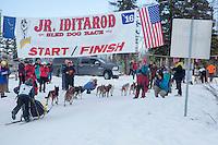 Chandler Wappett crosses the finish line of the 2016 Junior Iditarod in Willow, Alaska, AK  February 28, 2016