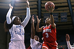 23 March 2015: Ohio State's Kelsey Mitchell (3) shoots over North Carolina's Stephanie Mavunga (1) and Brittany Rountree (11). The University of North Carolina Tar Heels hosted the Ohio State University Buckeyes at Carmichael Arena in Chapel Hill, North Carolina in a 2014-15 NCAA Division I Women's Basketball Tournament second round game. UNC won the game 86-84.